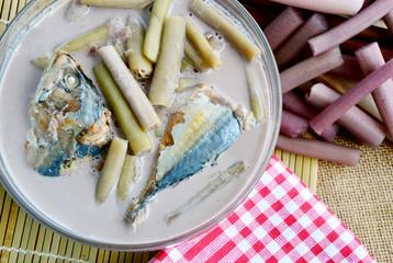 Lotus Stem and Mackerels Fish in Coconut Milk Soup (Thai name is gaaeng gathi saai buaa bplaa thuu neung) Traditional Thai food Lotus Menu.