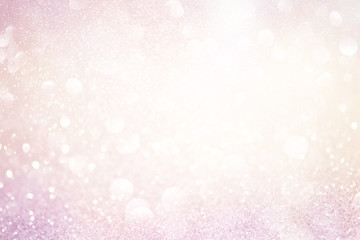pale pink glittering christmas lights. Blurred abstract background