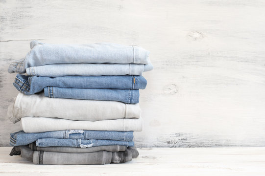 Stacked blue and grey jeans