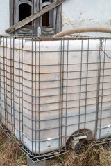 Plastic water tank. Imported water for construction.