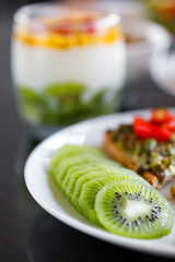 Slices of fresh and ripe kiwi fruit on the plate