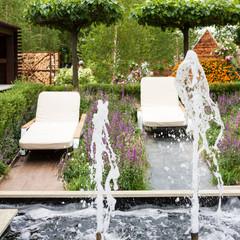 Deck chairs in a garden.
