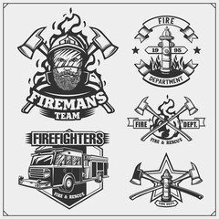 Set of firefighter emblems, labels and design elements. Vector monochrome illustration.