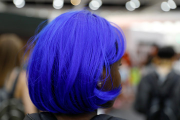 An attendee wears blue hair at KCON USA,, billed as the world's largest Korean culture convention and music festival, in Los Angeles
