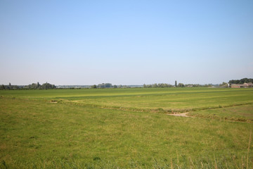 Fields, roads,bicycle lanes and canals along the dyke of the Hollandsche IJssel in Moordrecht, the Netherlands/