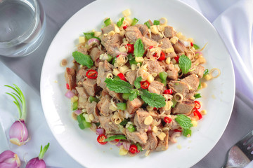 Spicy grilled pork salad with lemon grass and ginger