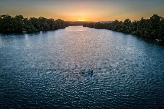 Kayaks On A River In Austin, Texas During Sunset
