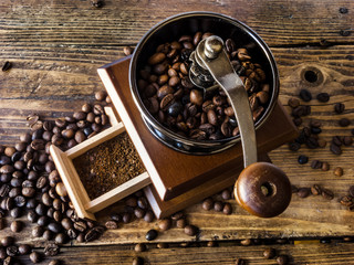 Wooden coffee grinder with ground coffee