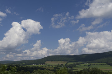 Summer Clouds Drifting Over Pennsylvania Farmland Landscape