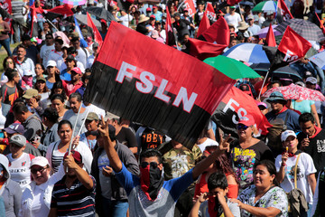 People take part in a march in support of Nicaragua's President Daniel Ortega in Managua