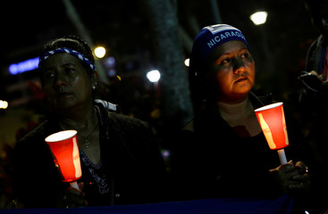 People in support of Nicaraguan protesters who are opposing Nicaraguan President Daniel Ortega, rally at the La Democracia square in San Jose