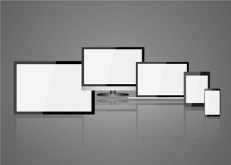 Collection of realistic modern blank screen lcd, led, TV, monitor, laptop, notebook, pad, phone on gray background. Electronics industry