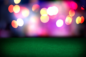 Empty poker table in casino. Blurred lights. Background for your design.