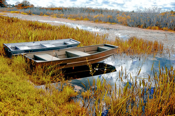 boats on a river shore autumn in the swamps