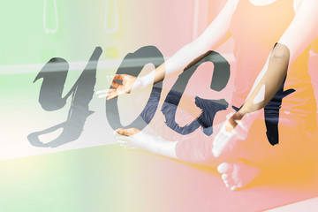 Young woman practicing yoga in  gray background.Young people do yoga indoor.Close up hands in meditating gesture. Copy space.