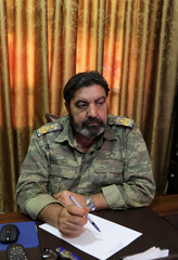 Colonel Haitham Afisi talks during an interview with Reuters at his office in the town of Azaz