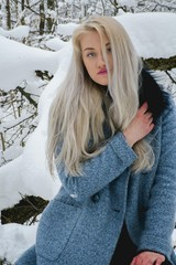 blonde in the winter forest