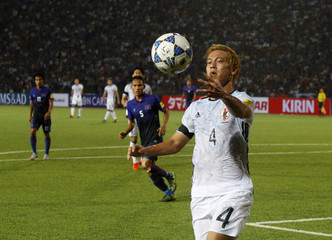 Japan's Keisuke Honda controls the ball against Cambodia during their 2018 World Cup qualifying soccer match at the Olympic Stadium in Phnom Penh