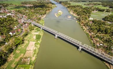 Aerial photo of long bridge cross Opak river at Kretek village, South Yogyakarta, Indonesia