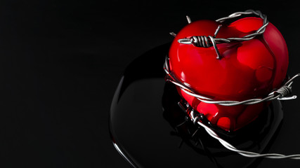Feeling the heartache, a wounded soul, help with depression and broken hearts concept with barbwire piercing a red heart and blood coming out of the wound on black background with copy space