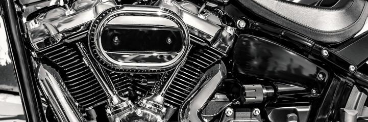 shiny motorbike engine, black and white