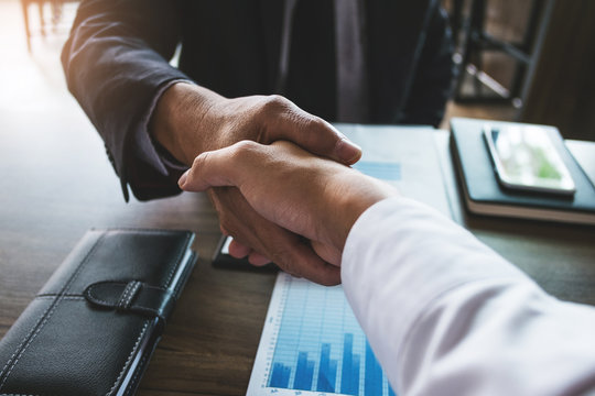 two business partnership handshake after discussing agreement deal investment trading