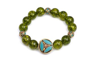 Peridot bracelet Beads green ore lucky stone decorate whit Chakra amulet white white isolated background