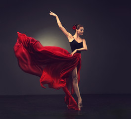 Ballerina. Young graceful woman ballet dancer, dressed in professional outfit, shoes and red...