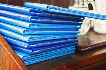 Stack of blue folders, selective focus.