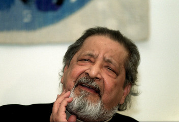 Writer V.S. Naipaul speaks during a press conference upon his arrival at Arlanda Airport, Stockholm
