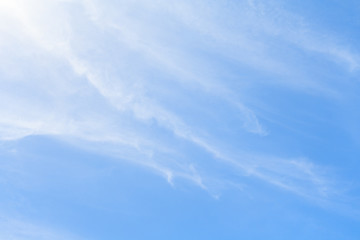 White feather clouds in azure sky as background