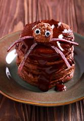 Halloween chocolate pancakes served with glaze