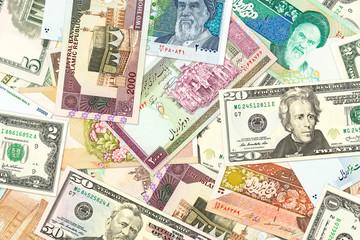 iranian rial and american dollar banknotes indicating bilateral economic relations