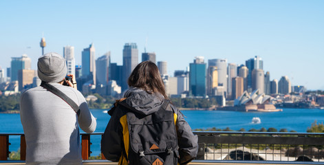 Couple of tourism stand on view point in Sydney zoo