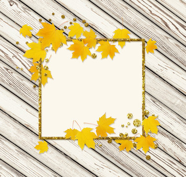 Autumn maple twig with yellow leaves on wood