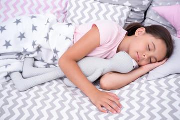 Sleep concept. Little girl sleep in bed. Cute child sleep with soft toy. Sleep well, stay healthy