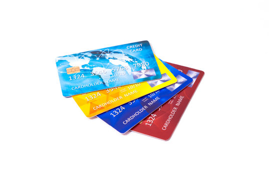 Closeup of a set of colourful credit cards isolated on white background