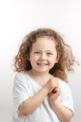 positive red-haired kid posing to the camera. healthy child in good mood. sparkling kid's eyes radiating joy