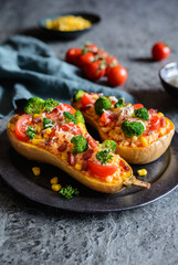 Butternut Squash stuffed with rice, bacon, broccoli, tomato, corn and cheese