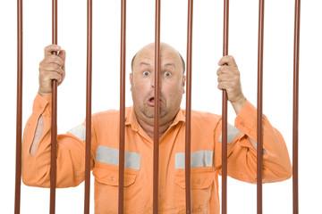 A criminal behind bars in prison.