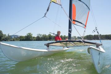 enjoying extreme sailing with racing sailboat