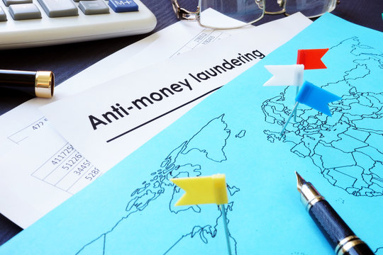Anti-Money Laundering (AML) documents and world map.