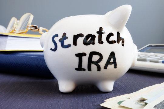 Stretch ira written on a piggy bank. Retirement.