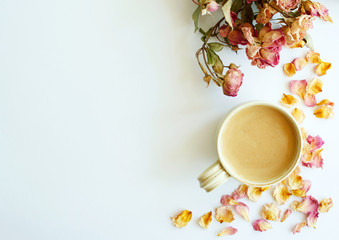 Picture of autumn background with dry roses and cup of coffee with copy space