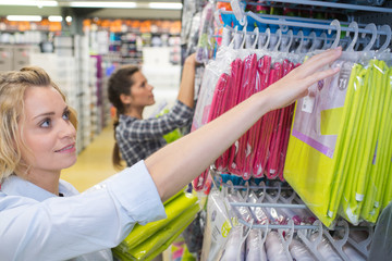 two women choose napkins in the shop for party