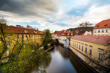 Colorful houses, Certovka (the Davil's Stream), Kampa Island, the railing is decorated with the locks of love, Prague