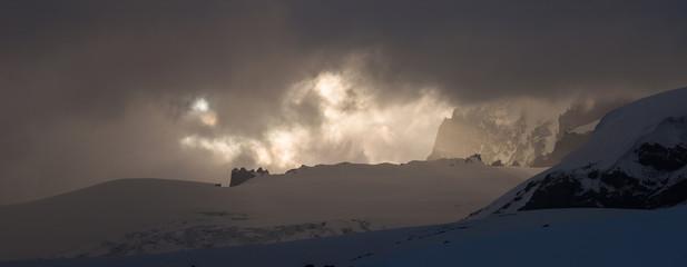 Dramatic dark stormy sky over Mt. Elbrus slope.