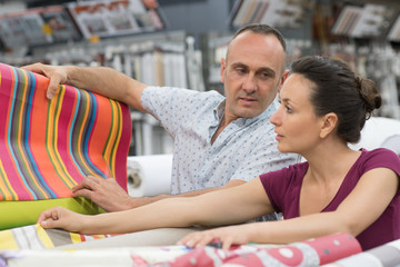couple standing in fabric store