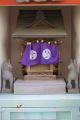 Shinto neighborhood sanctuary miniature dedicated to Inari fox deity in Komagome's Somei Ginza shopping street.
