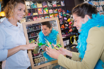 female friends buying dressing up accessories